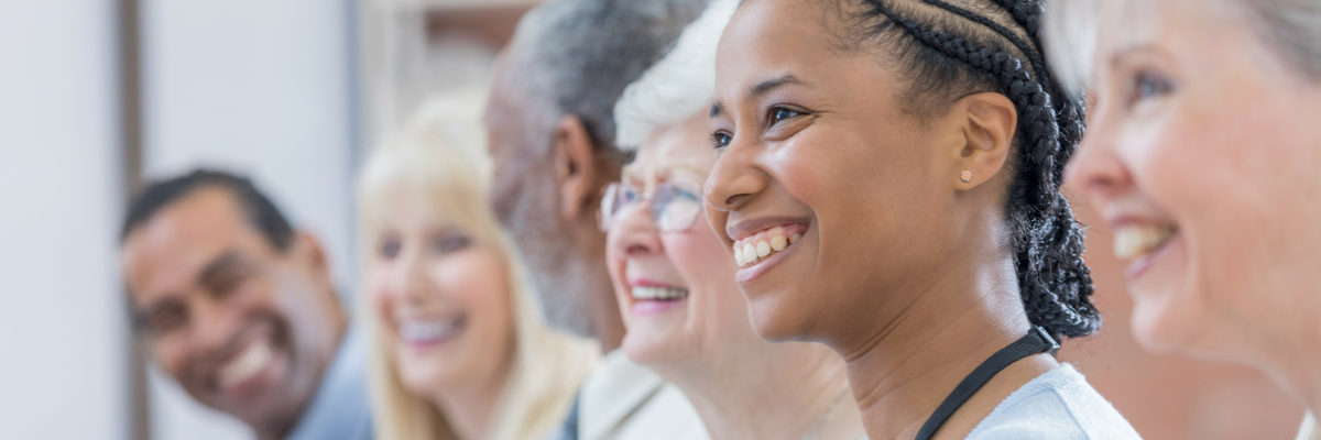 Small group of diverse smiling adults | Sparkhouse Blog