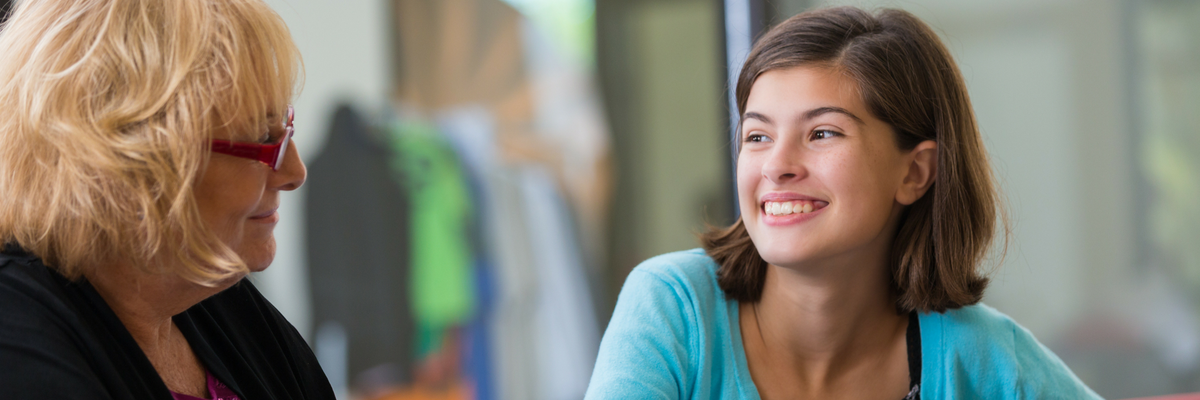 Teenage girl meeting with caring adult ministry leader | Sparkhouse Blog