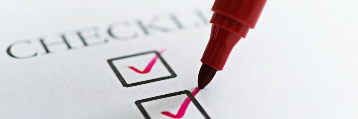 Marker tip checking off a box on a checklist | Sparkhouse Blog