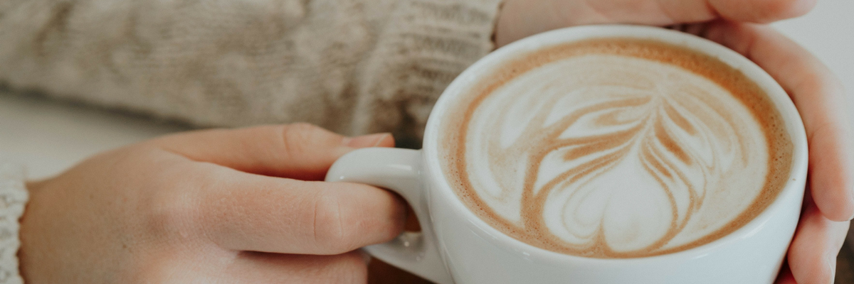 Photo of a person holding a relaxing coffee cup. Find spiritual fulfillment by filling your cup during Holy Week | Sparkhouse Blog
