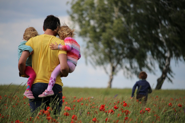 A father spends time outdoors with three children | Sparkhouse Blog