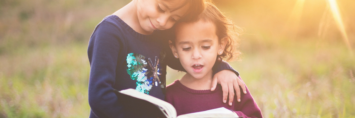 Two children read the Bible together | Sparkhouse Blog