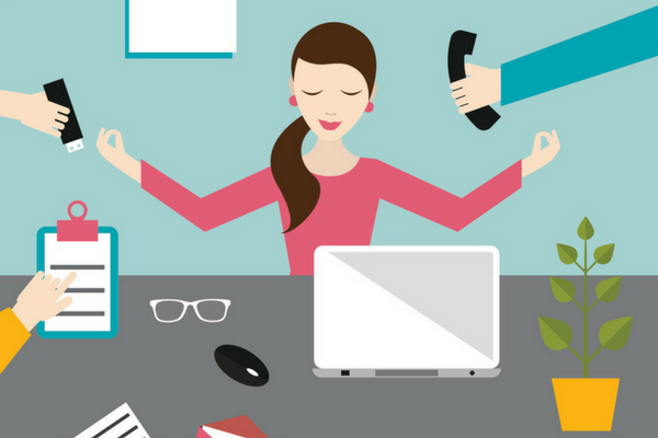Woman looks zen amidst work chaos. Just like you can during Holy Week | Sparkhouse Blog
