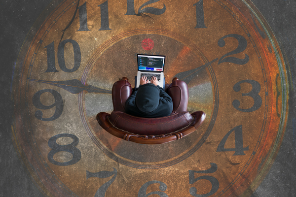 Church worker sits at computer in the middle of a giant clock | Sparkhouse Blog