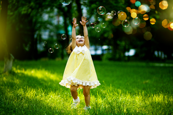 Little girl plays with bubbles | Sparkhouse Blog