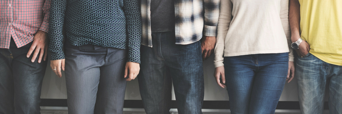 Small group of people stand next to each other | Sparkhouse Blog