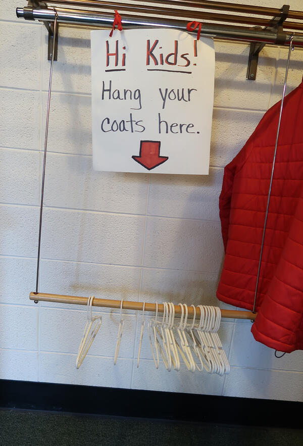 A lowered coat rack at a good height for children